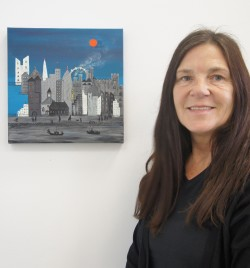 Eve McDougall with one of her paintings