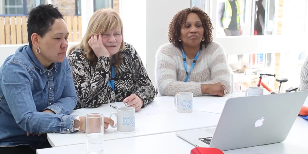 Peer supports Gemma, Sue and Christine in video editing